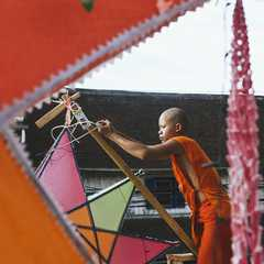 A novice monk decorating the temple for the festival.