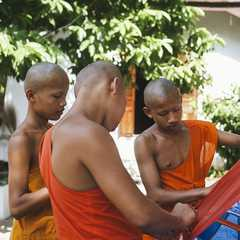 Novice Monks making a lantern made from Bamboo and rice paper