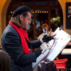 Street artist doing a portrait of a tourist