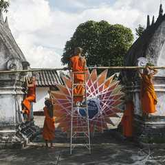 A group of novice monks decorating the temple for the festival