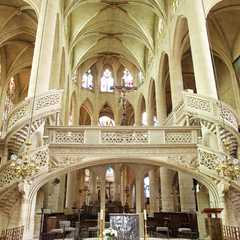 The nave, showing the rood screen, pulpit and ceiling details