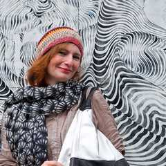 Katharina's portrait with a hypnotizing piece by Never2501 as backdrop