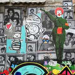 "A section of the ever-changing ""Wall of Fame"" at Carrer de la Nau in Barcelona's El Borne district."