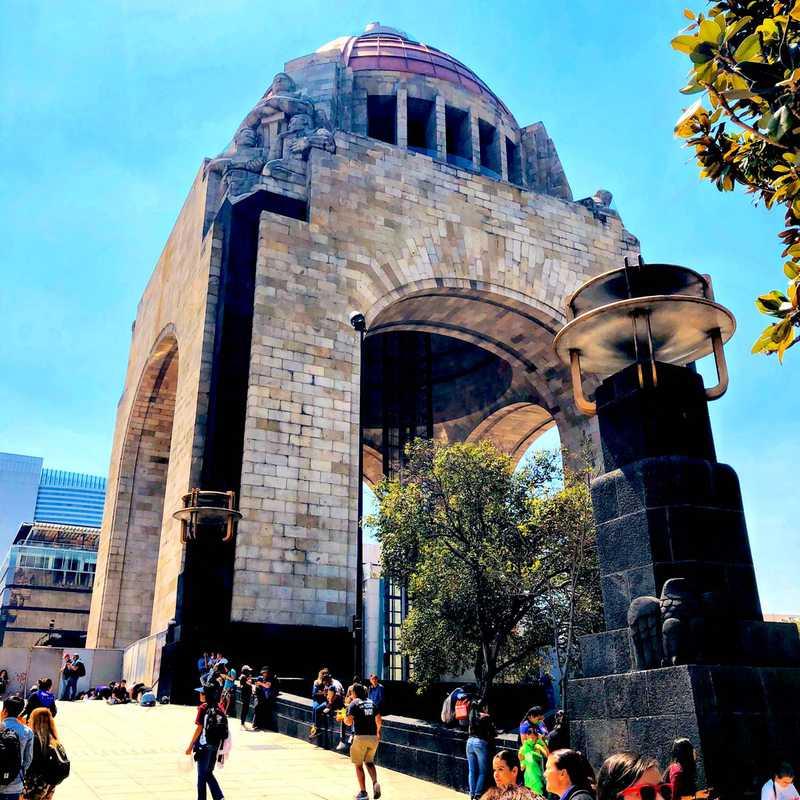 Museo Nacional de la Revolución History exhibits below a 1930s monument
