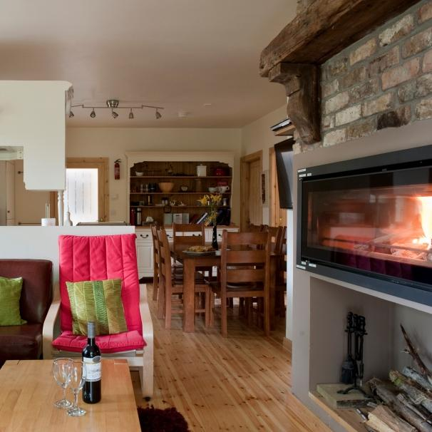 The spacious open plan interiors of the Coach House.  Lots of room for the whole family to settle down by the large open fire
