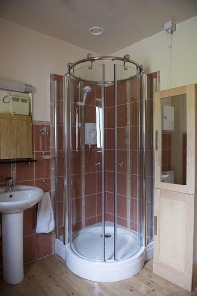 There is also a bathroom on the ground floor with a large walk-in shower.