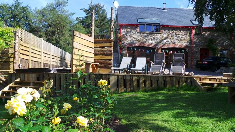 The Coach House has access to a fabulous outdoor hot-tub.  What a perfect way to end the day!
