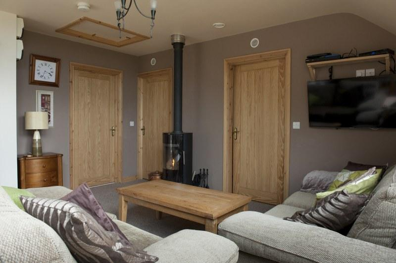 The contemporary interiors include a stunning wood-burning stove to curl up in front of..