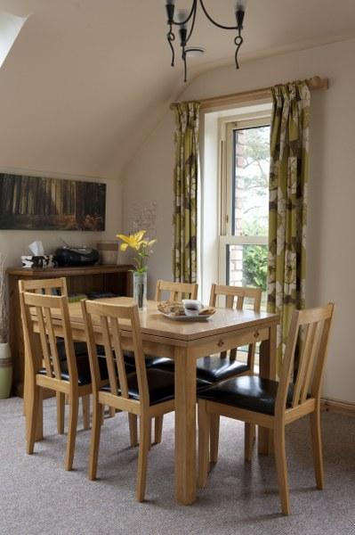 Settle down to dinner at the pretty dining table and enjoy those views across to the Lough