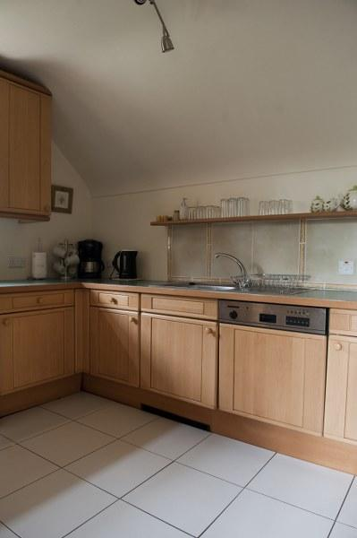 The generous kitchen is very well equipped with everything you could need.