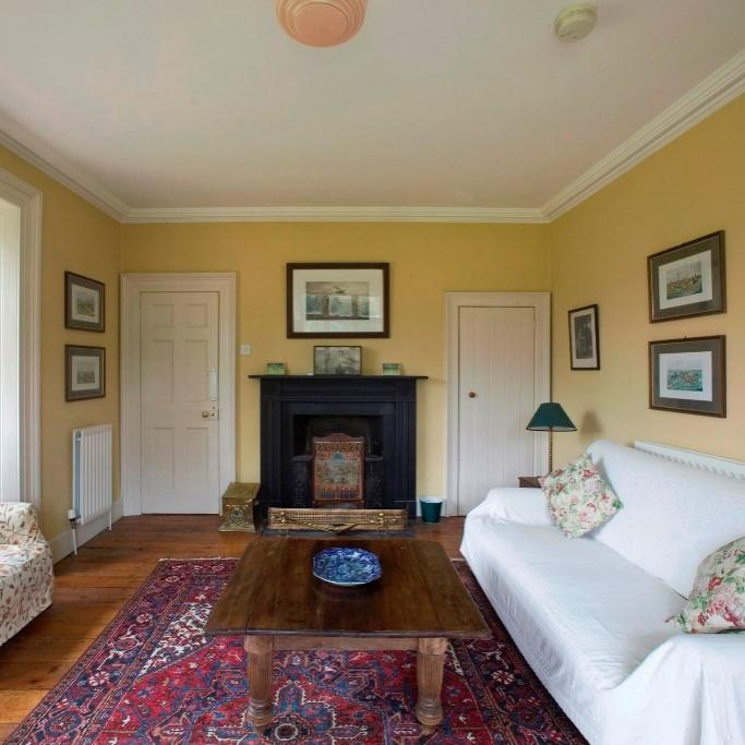 The charming formal living room in Ballealy cottage.  Light up the fire and enjoy a good old catch up over a nice bottle of wine.