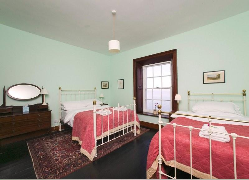 The second bedroom is another spacious room. There are two beds in here, a double and a twin, perfect for families with young children.