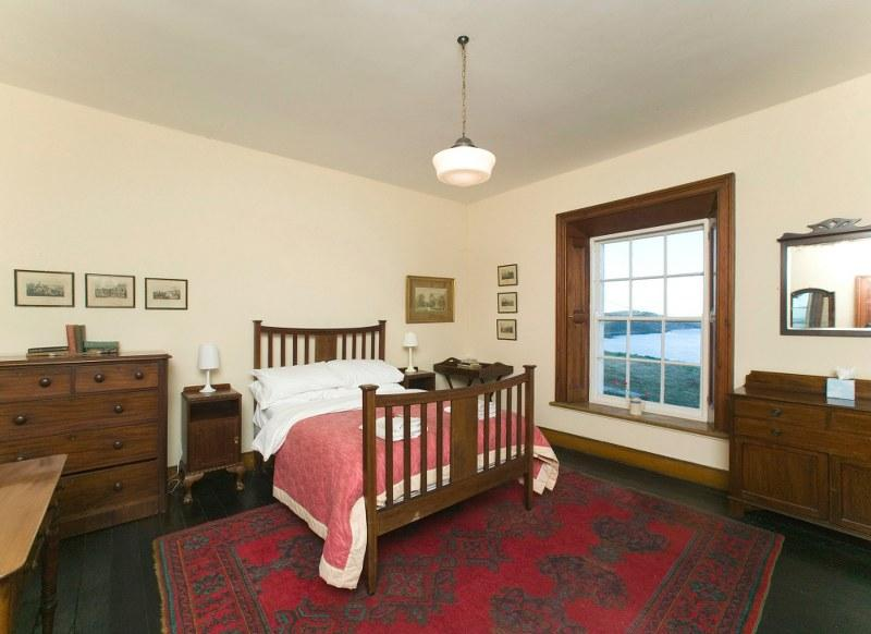 One of two generous bedrooms in the cottage, a double room with lots of period touches.