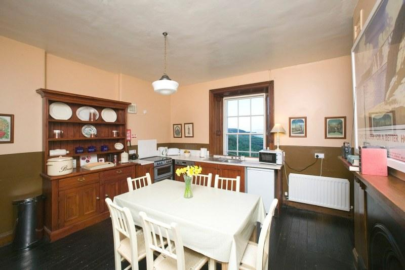 We love the traditional kitchen with it's gorgeous views, period fireplace and family-friendly square table..