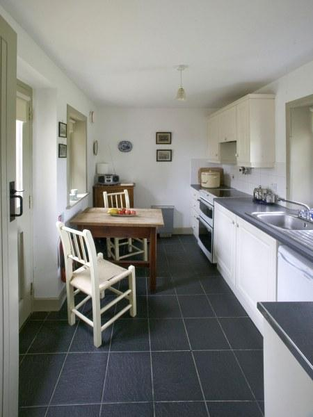 The contemporary kitchen in Drum Gate Lodge is just right for two.