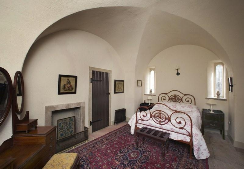 Stunning vaulted ceilings in the bedroom give the room a romantic, traditional feel.