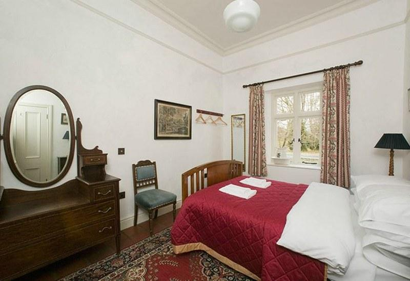 The second of the two spacious double bedrooms, with lovely views out to the estate.