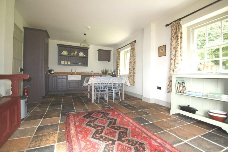 The pretty kitchen in the lodge has bags of room and lots of character with its tiled floor and striking units