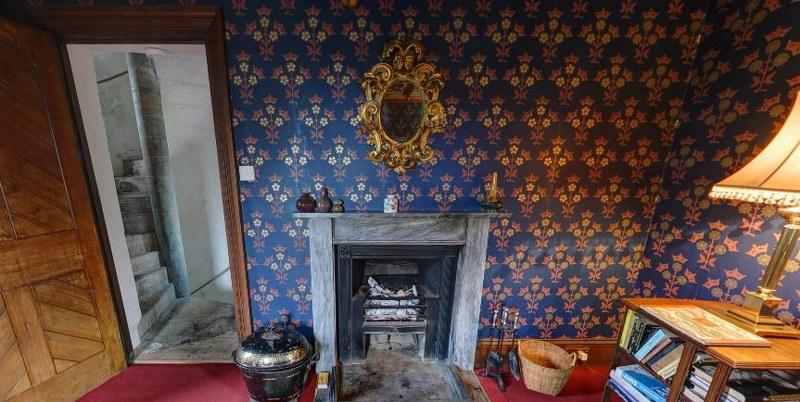 Sumptuous period interiors include the stunning sitting room with its striking blue wall-paper