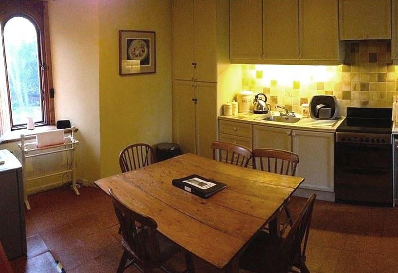The generous kitchen has a lovely farmhouse table, perfect for breakfast,