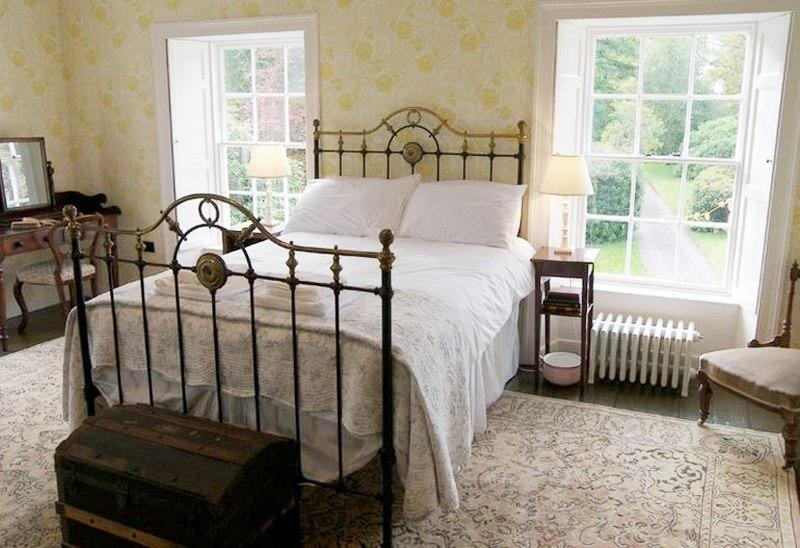 A room with a view, this beautiful double bedroom has stunning views out to the gardens from two large sash windows.