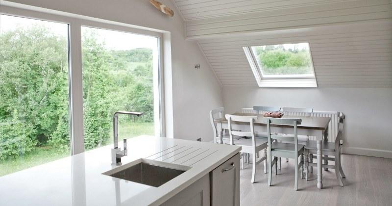 The kitchen and dining areas are set upstairs to maximise the stunning views