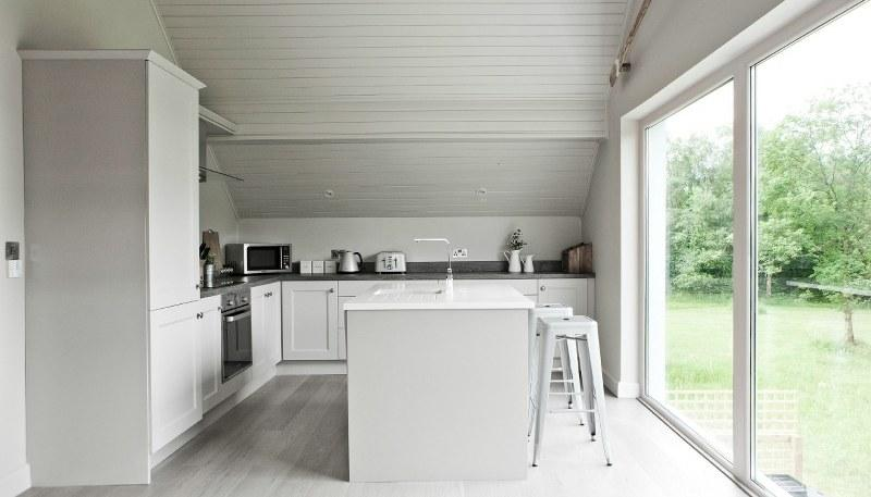 The spacious kitchen includes a charming breakfast bar area, perfect for that glass of bubbly before dinner
