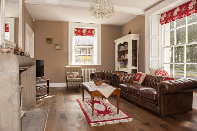 Step into the gorgeous large sitting room and enjoy the light streaming in from large sash windows.