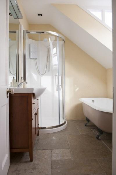 The generous family bathroom at The Brooke has a lovely roll top bath to sink into once the kids are asleep!