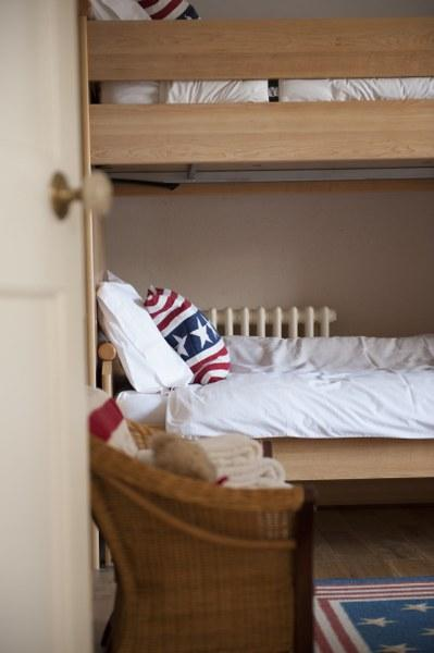 The first of the two charming twin rooms - the kids will love the bunk beds!