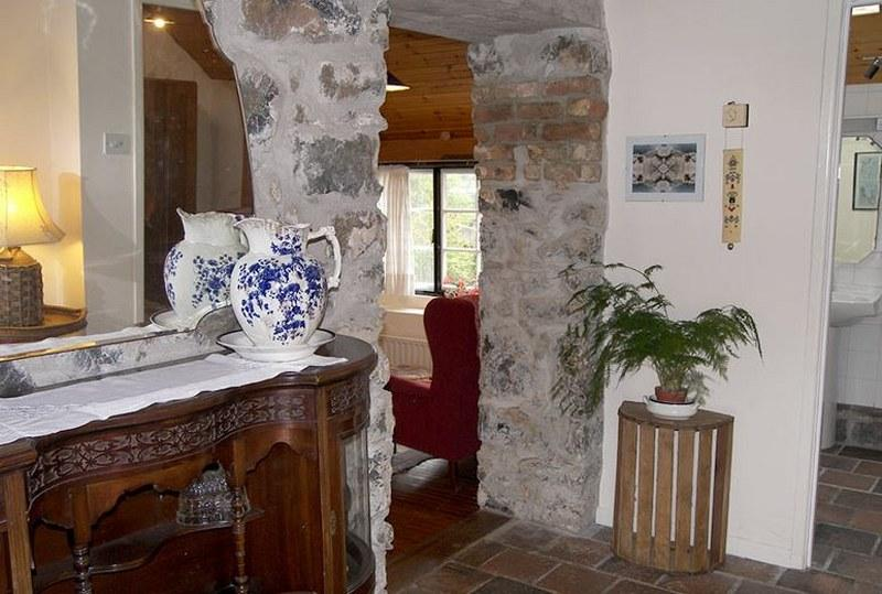 We love the exposed brick-work and period pieces in this charming cottage.