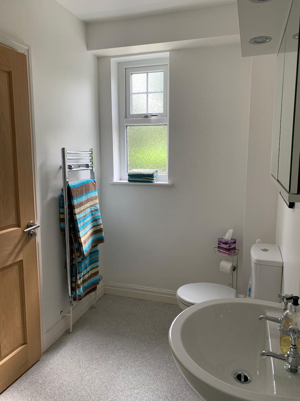 En suite shower room with complimentary toiletries and cosy towels