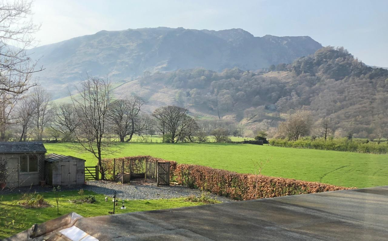 View from room 4 over the fields to Castle Crag