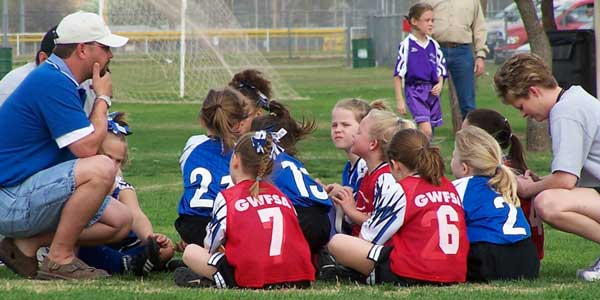 youth sports girls team huddle