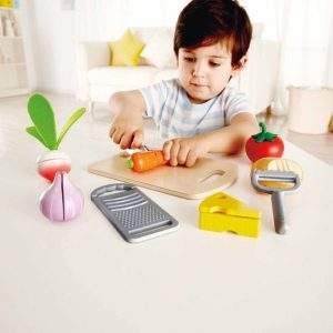 Child Plays With Toy Cutting Board
