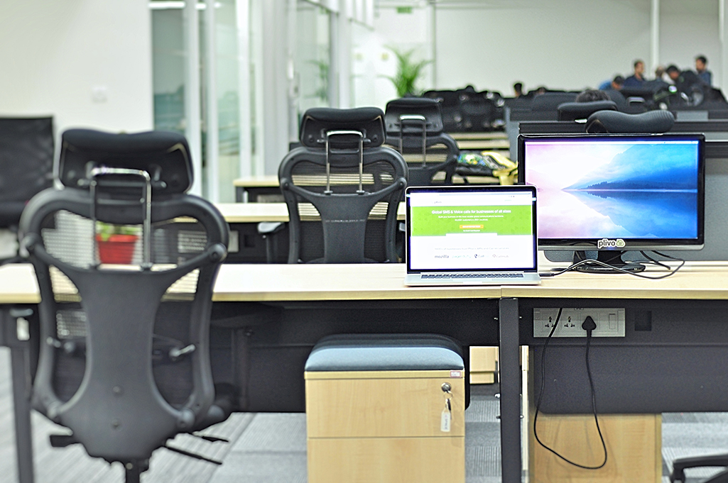 Plivo office laptop with drawer and monitor
