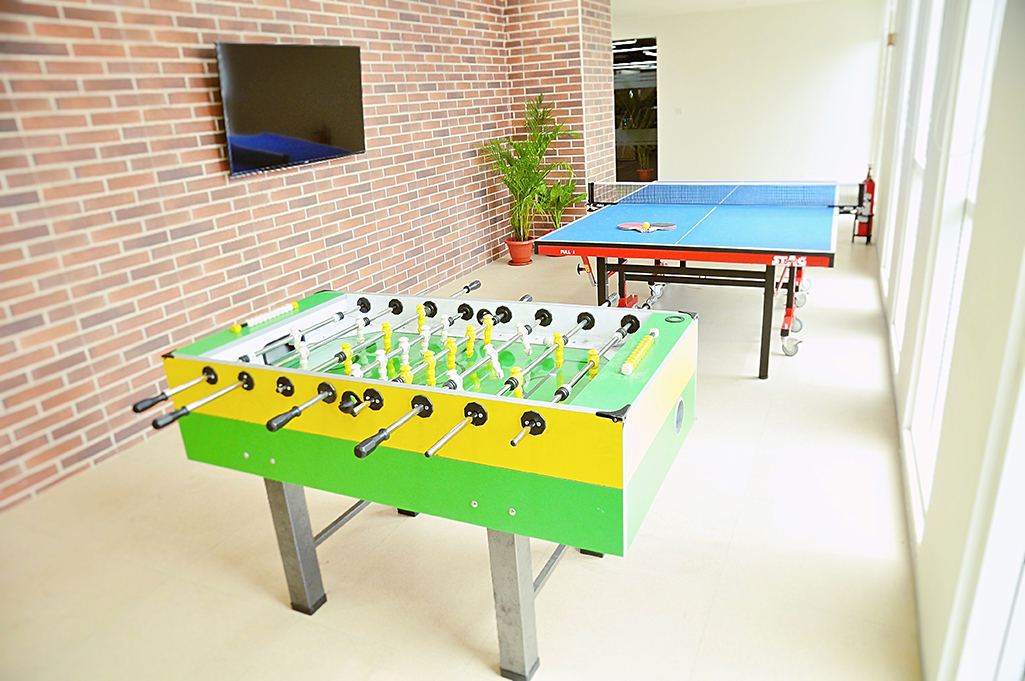 Game room with foosball, tv, xbox, and ping pong table