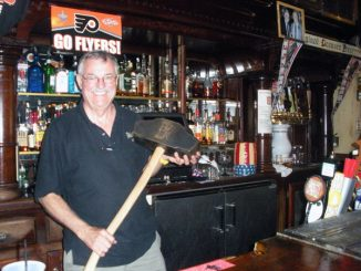 McGillin's Old Ale House co-owner Chris Mullins holds the Philly Beer Week mallot