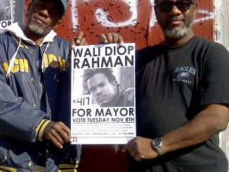 James Larry Grant showed off the Rahman for Mayor sign, with his brother, Cecil B. Marks, in front of their childhood home