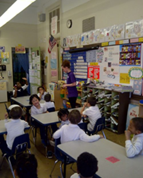 Kindergarten students listened to instructions from their teacher.