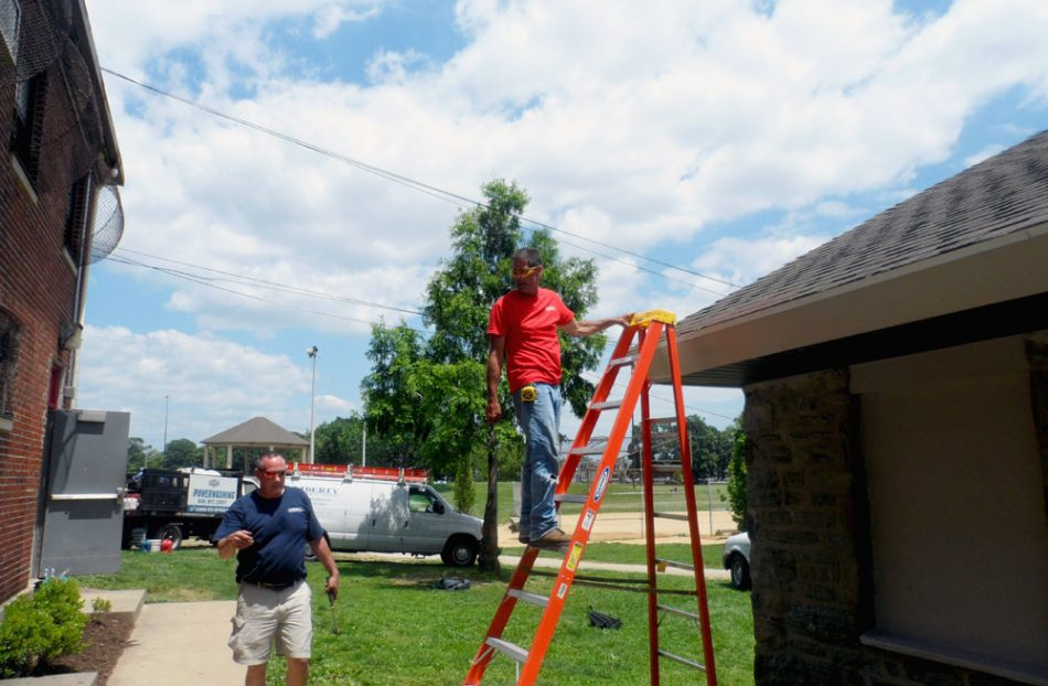 Roofers fix recreation center.