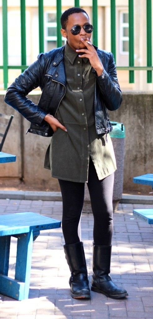 Openly gay Asanda Madosi smokes a cigarette in between classes at the University of Witwatersrand.