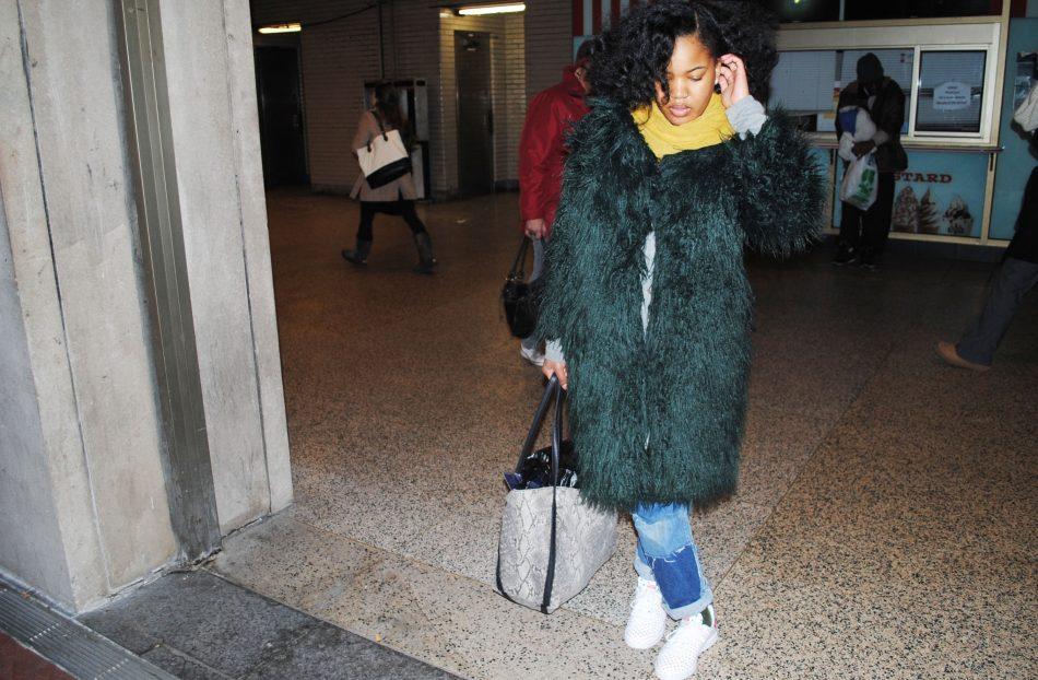 Jasmine Wilson poses in a green fur coat.