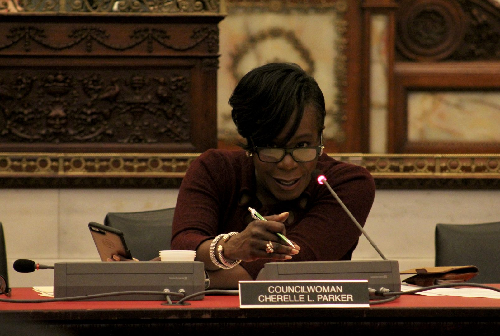 Majority Leader Cherelle Parker sits at a table during the March 11 hearing and gestures forward with one hand. She is leaning forward while speaking into a microphone.