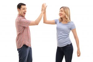 Man and woman high five each other