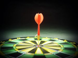 dart on board in bullseye