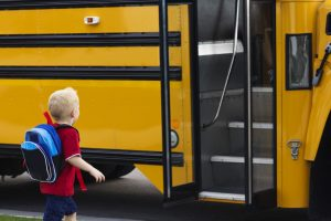 child and the school bus ride