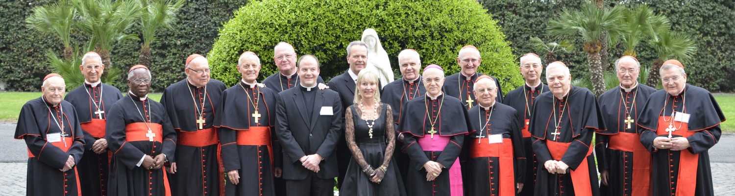 Honorees Tim and Steph Busch and Archbishop Viganò meet for a photo with Very Rev. Peter Harman and all Their Eminences present at the Dinner.