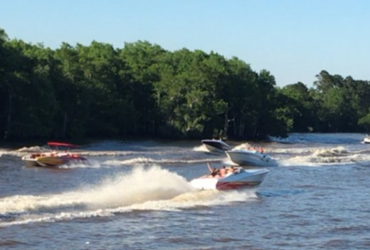 Watching the Poker Run on the Tickfaw River; from my daughters camp