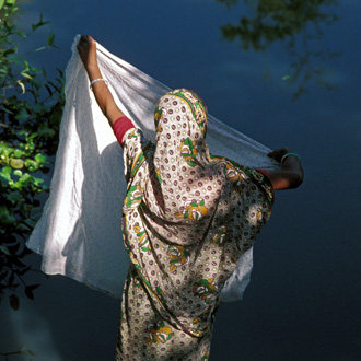 A woman washing a sari in Matlab